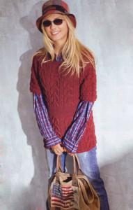 Красный приталенный пуловер с косами